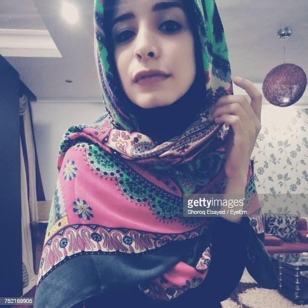 Portrait Of Young Woman Wearing Colorful Hijab At Home
