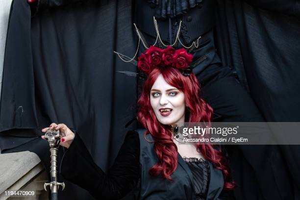 portrait of young woman wearing costume during halloween - cosplay stock pictures, royalty-free photos & images