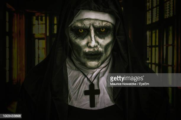 Portrait Of Young Woman Wearing Demon Nun Costume During Halloween