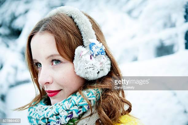 Portrait of young woman wearing earmuffs