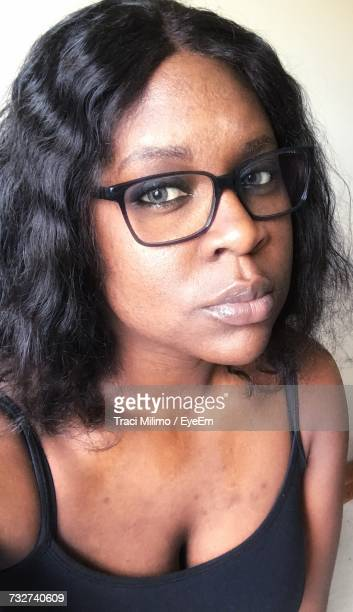 portrait of young woman wearing eyeglasses - grey eyes stock pictures, royalty-free photos & images