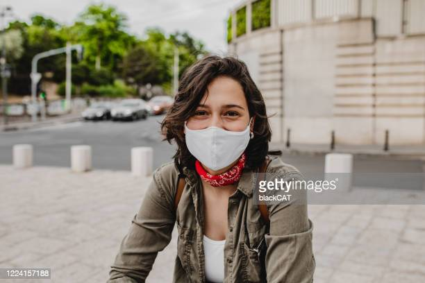 portrait of young woman wearing face mask - cat face mask stock pictures, royalty-free photos & images