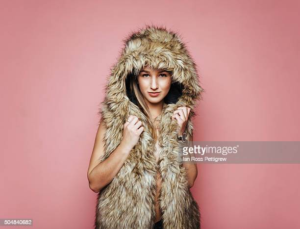 Portrait of young woman wearing fur coat