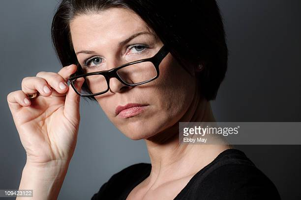 Portrait of young woman, wearing glasses