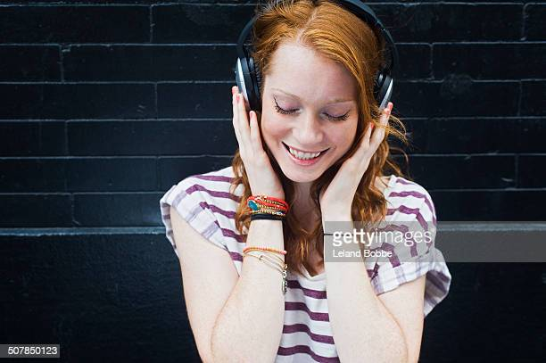Portrait of young woman wearing headphones