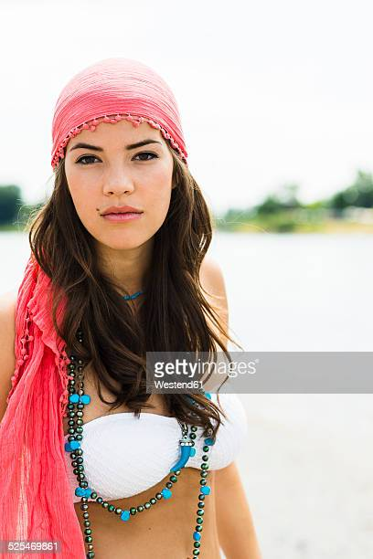 Portrait of young woman wearing headscarf on the beach