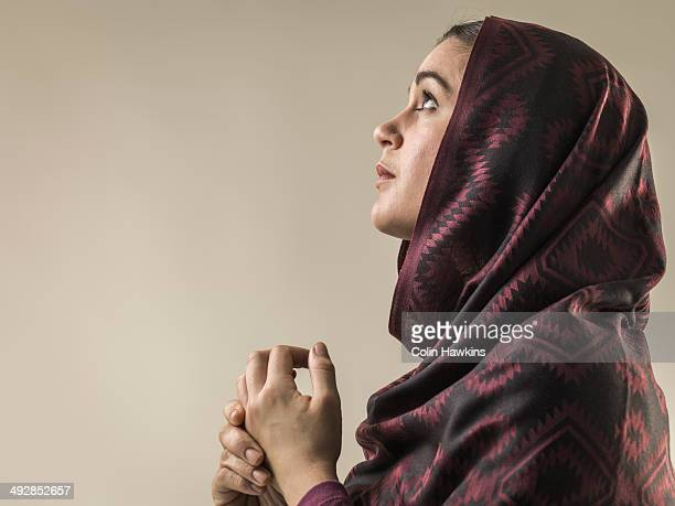 portrait of young woman wearing hijab head scarf - muslim praying stock pictures, royalty-free photos & images