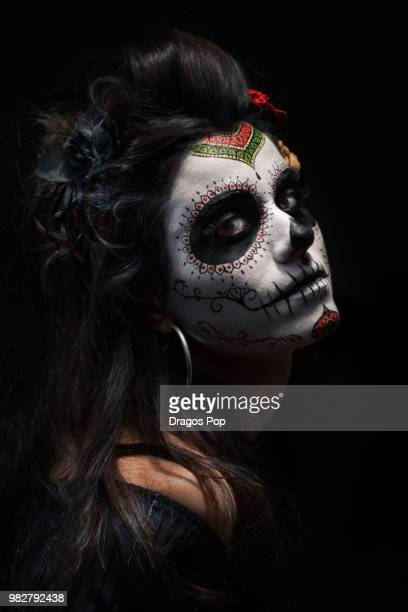 portrait of young woman wearing la calavera catrina make-up - la catrina stock photos and pictures