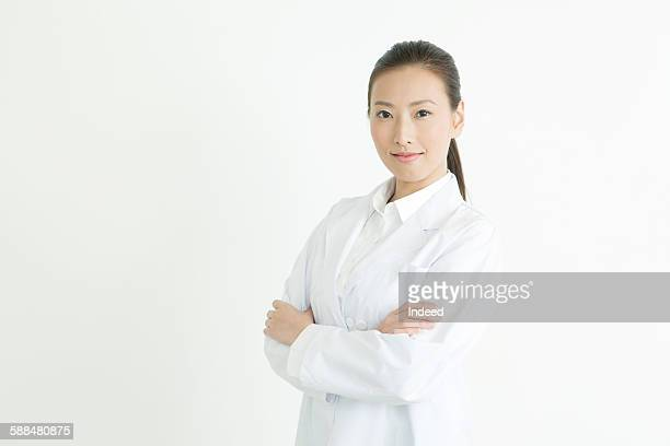 Portrait of young woman wearing lab coat