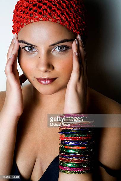 portrait of young woman wearing lots of bangles - indian cleavage stock pictures, royalty-free photos & images