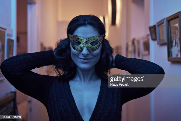 Portrait of young woman wearing mask at New Years party