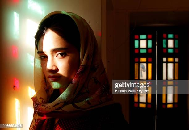 portrait of young woman wearing scarf in home - tehran stock pictures, royalty-free photos & images