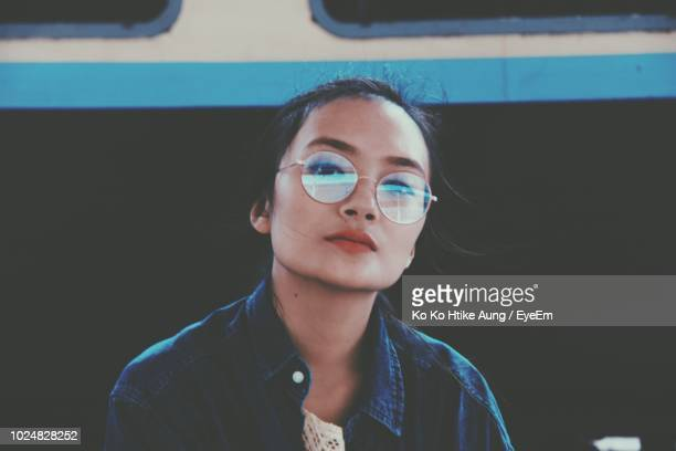 portrait of young woman wearing sunglasses - ko ko htike aung stock pictures, royalty-free photos & images