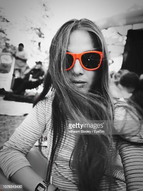 portrait of young woman wearing sunglasses - isolated color stock pictures, royalty-free photos & images