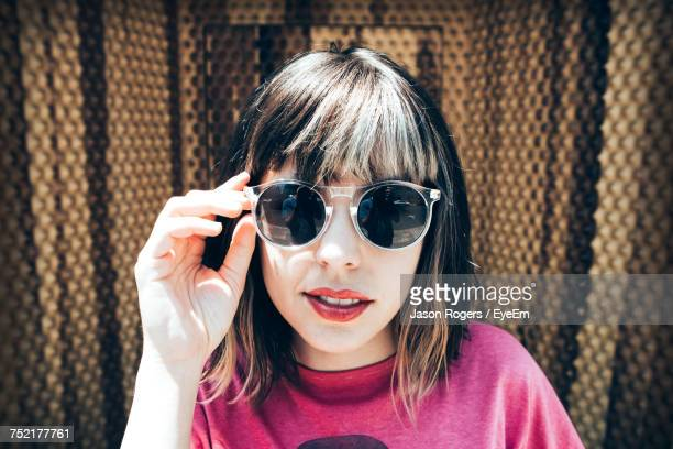 portrait of young woman wearing sunglasses - bangs stock photos and pictures