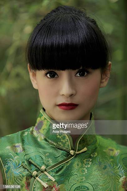 Portrait of young woman wearing traditional Chinese dress.