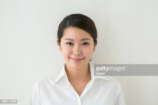 portrait of young woman, wearing white shirt - 白い服 ストックフォトと画像