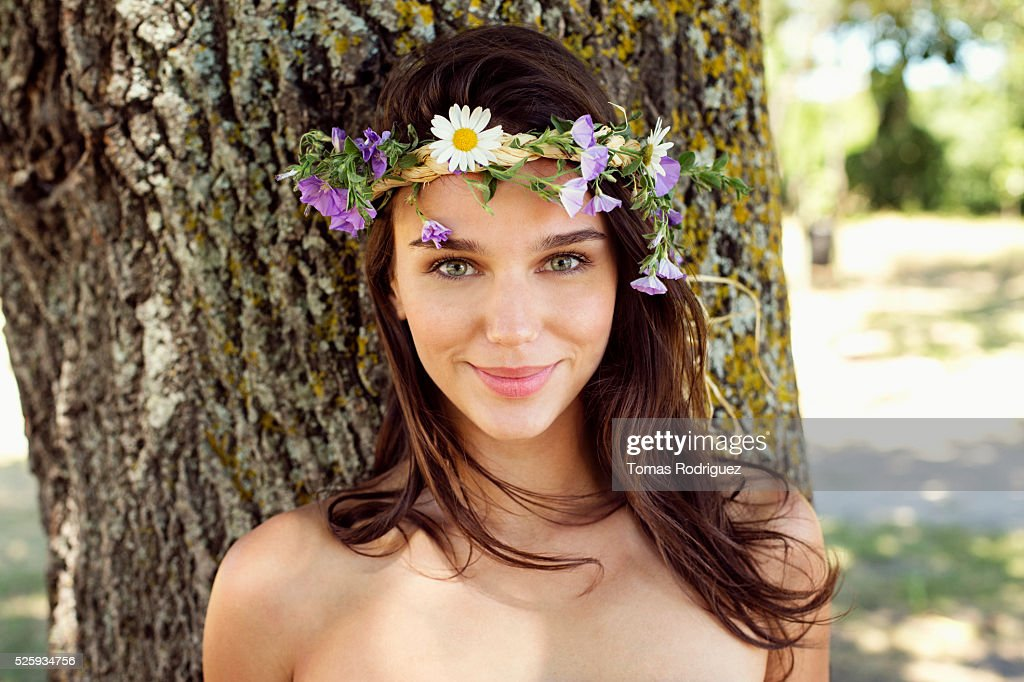 Portrait of young woman wearing wreath : Bildbanksbilder