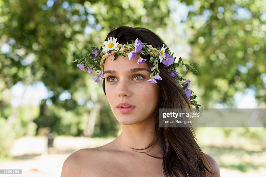 Portrait of young woman wearing wreath : Stock Photo