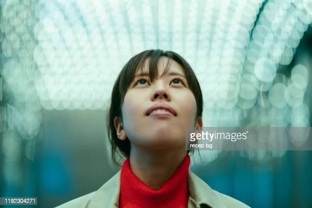portrait of young woman while looking up at night - igniting stock pictures, royalty-free photos & images