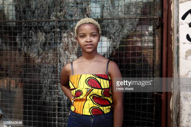 Portrait of young woman with African print top