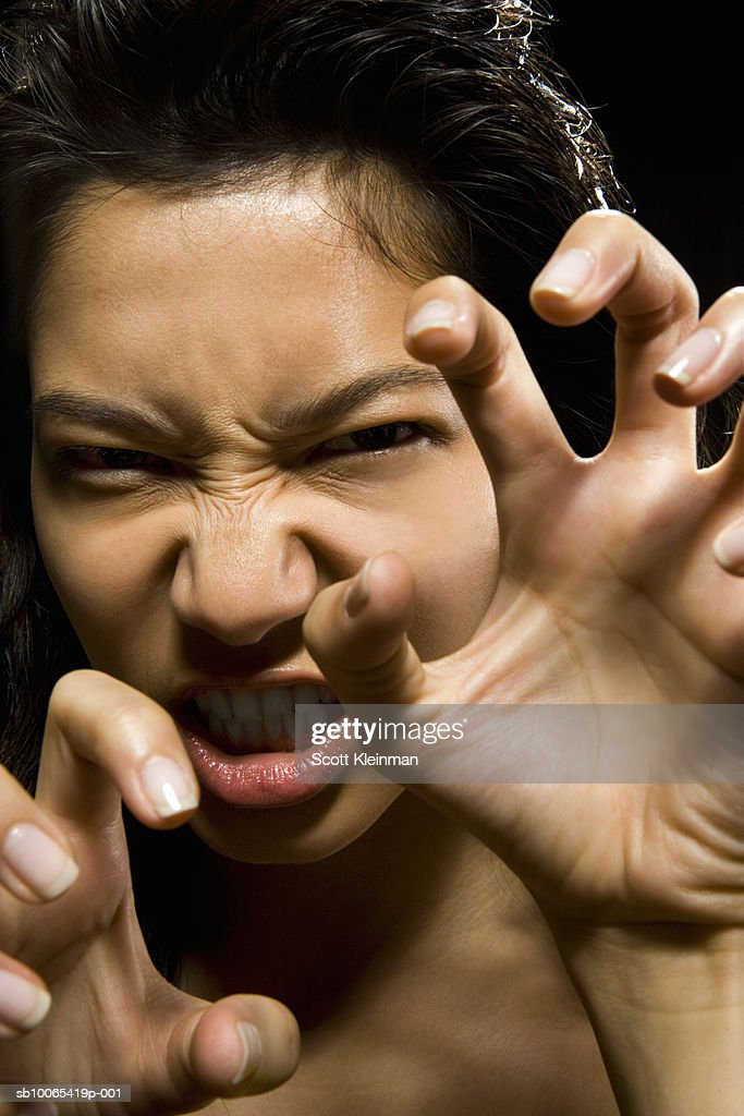 Portrait of young woman with aggressive attitude : Foto stock
