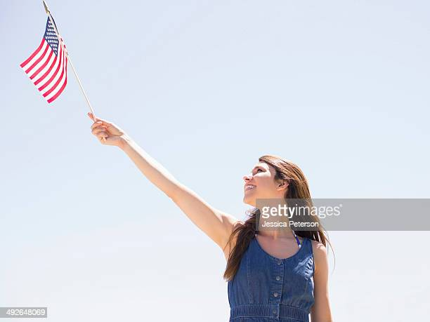 Portrait of young woman with american flag, Salt Lake City, Utah, USA