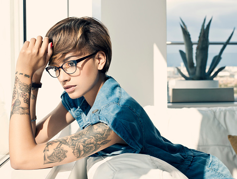 Portrait of young woman with arm tattoo - gettyimageskorea