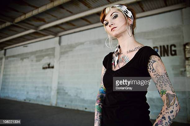Portrait of Young Woman With Arm Tattoos