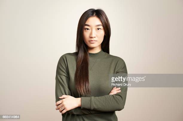 portrait of young woman with arms folded - blouse ストックフォトと画像