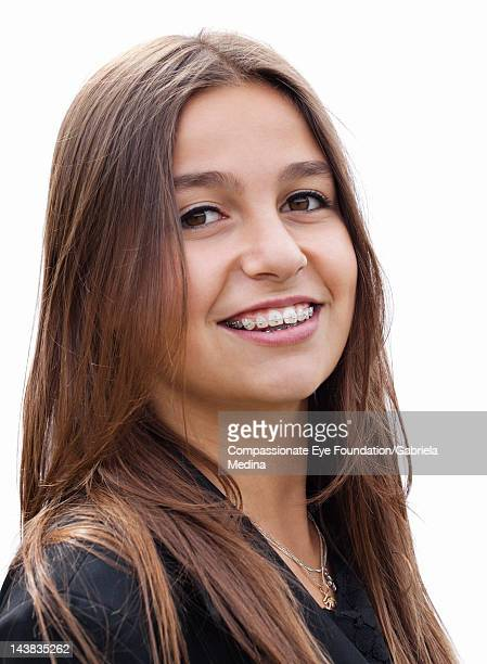 """portrait of young woman with braces, smiling - """"compassionate eye"""" stock pictures, royalty-free photos & images"""