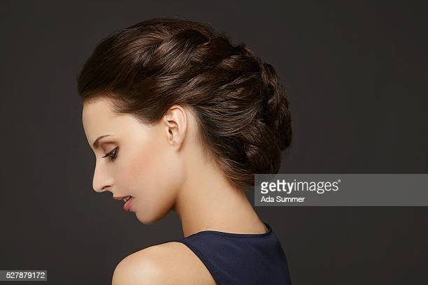 portrait of young woman with braided hairbun, studio shot - up do stock pictures, royalty-free photos & images