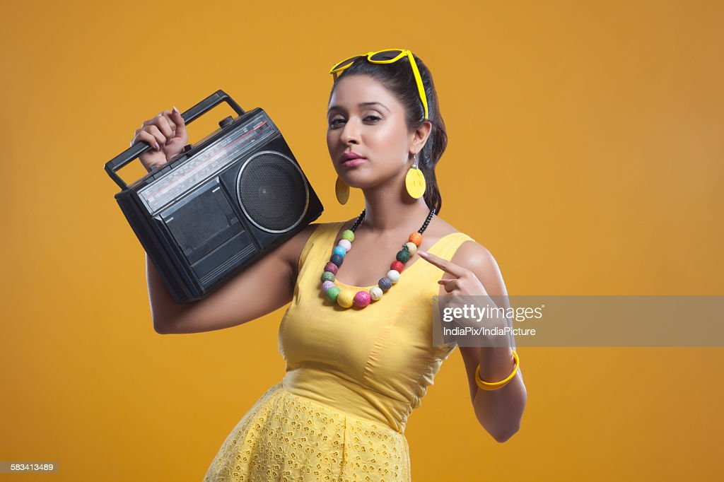 Portrait of young woman with cassette player : Stock Photo