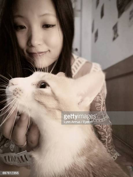 portrait of young woman with cat - lynn pleasant stock pictures, royalty-free photos & images
