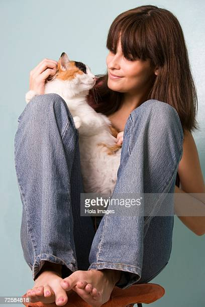 Portrait of young woman with cat