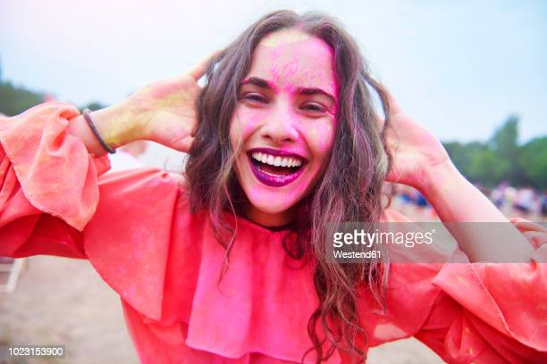 portrait of young woman with colour powder at music festival - festival goer stock pictures, royalty-free photos & images