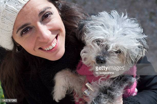 portrait of young woman with dog - female hairy arms stock photos and pictures