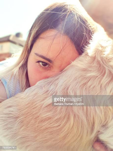 portrait of young woman with dog - hairy woman stock photos and pictures