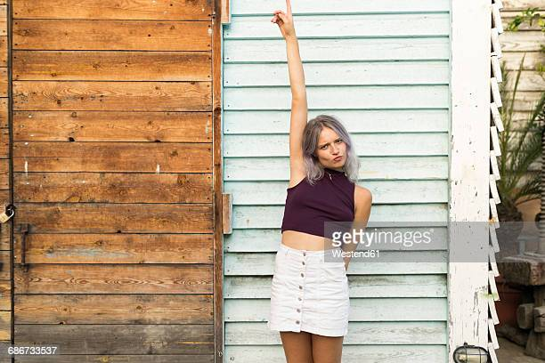 portrait of young woman with dyed hair celebrating - white skirt stock photos and pictures