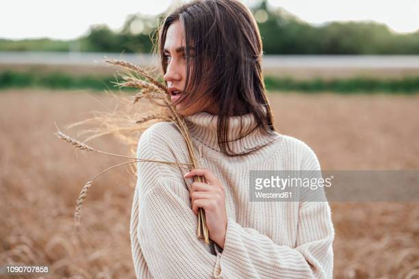 portrait of young woman with ears wearing oversized turtleneck pullover - brown hair stock pictures, royalty-free photos & images