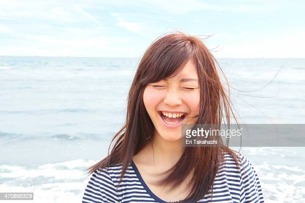 portrait of young woman with eyes closed, laughing - 20代 ストックフォトと画像