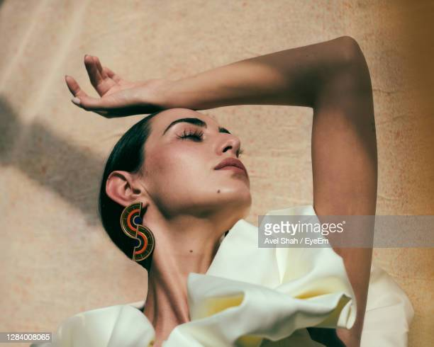 portrait of young woman with eyes closed - beauty stock pictures, royalty-free photos & images