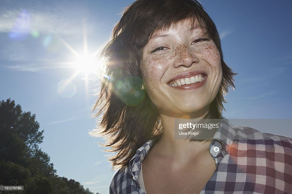Portrait of young woman with freckles, close up : Stock Photo