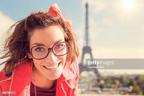 "portrait of young woman with glasses at the eiffel tower. - ""martine doucet"" or martinedoucet bildbanksfoton och bilder"