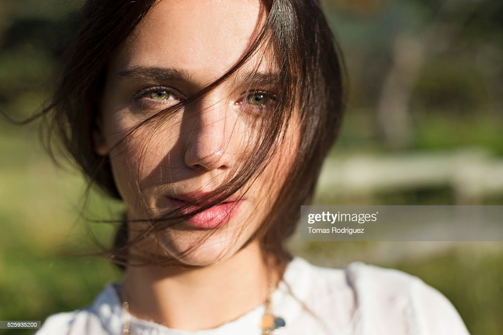 Portrait of young woman with hair on face : Stock Photo