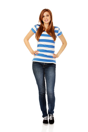 Portrait Of Young Woman With Hands On Hip Against White Background - gettyimageskorea