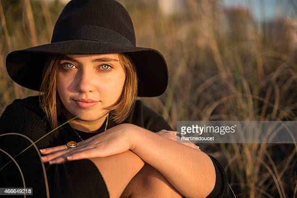 "portrait of young woman with hat on beach at sunset. - ""martine doucet"" or martinedoucet stock pictures, royalty-free photos & images"