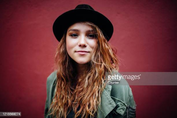 portrait of young woman with hat - dyed red hair stock pictures, royalty-free photos & images