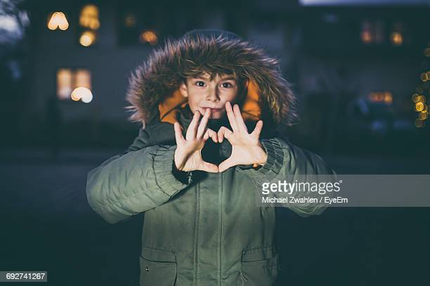 Portrait Of Young Woman With Heartshape Hands