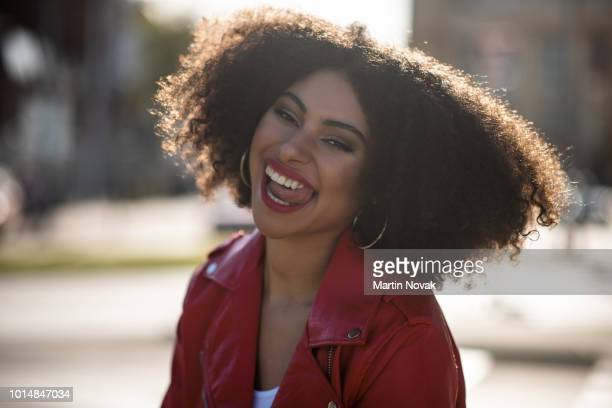 portrait of young woman with her tongue out - sneering stock pictures, royalty-free photos & images